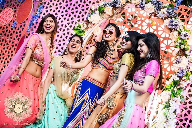 Nayana and Jai | Amazing Delhi wedding | Proposal story | Proposal ideas | The bride with her shades on smiling and having a gala time with her friends.