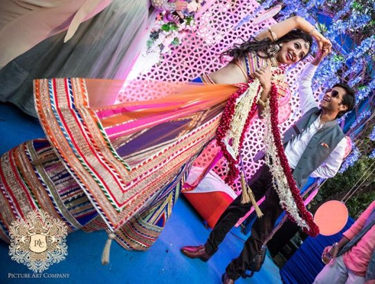 Nayana and Jai | Amazing Delhi wedding | Proposal story | Proposal ideas | The bride and the groom dancing together in the mehendi function.