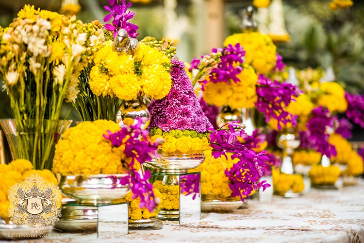 Nayana and Jai | Amazing Delhi wedding | Proposal story | Proposal ideas | The pink and yellow decor of the pooja day looks gorgeous.