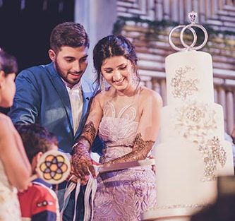Sagar and Subiya | Destination wedding in Bali | The bride and the groom cutting their recepton cake.