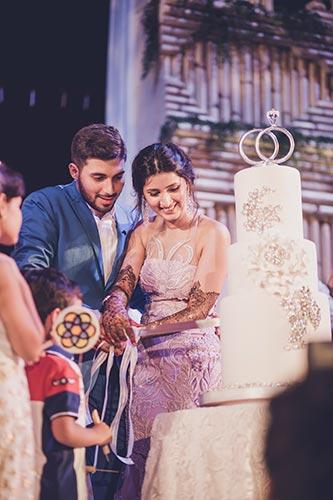 Sagar and Subiya   Destination wedding in Bali   The bride and the groom cutting their recepton cake.