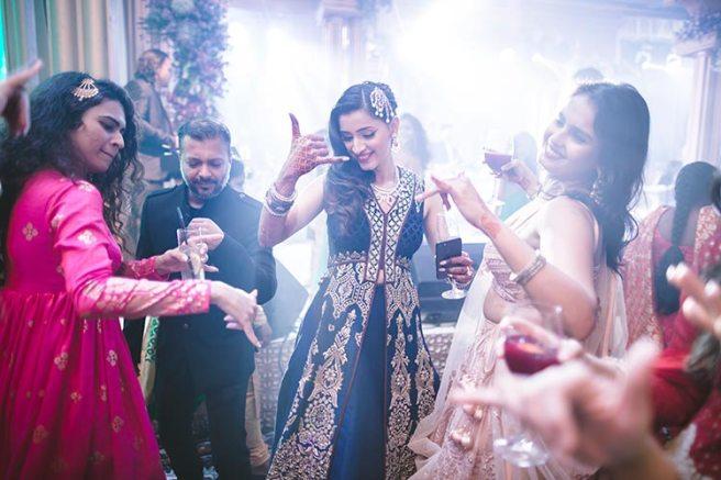 Sagar and Subiya   Destination wedding in Bali   The bride dancing on fun numbers in her beautiful green outfit.