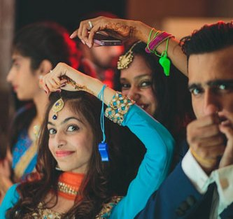 Nimisha and Hemant   Temple wedding in Delhi   Friends and family whistling during the fun functions.