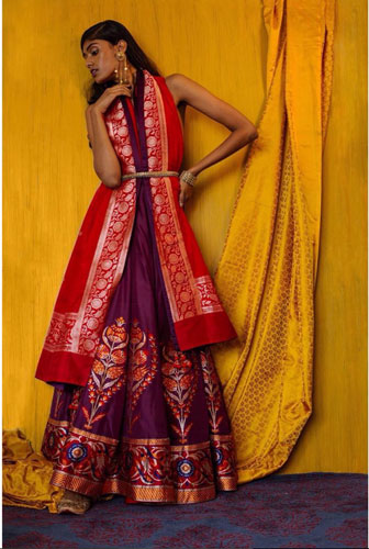 pretty purple benarsfi lehengas with vermillion red benarsfi dupatta draped behind the neck with a waist belt from ekaya bananas