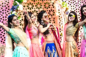 Nayana and Jai | Mehndi photos | Indian bride with her friends in colourful outfits