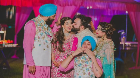 Bavleen and Kushal | Destination wedding in Goa | The color coordinated looks with a smile while the groom showers his love on the bride.