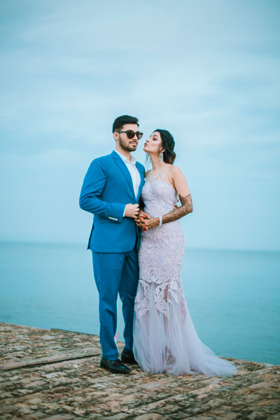 Sagar and Subiya | gorgeous Bali wedding with the couple on the beach side | groom in a blue suit and the bride in a lilac gown | pretty pout poses | candid couple shoot | wedding by crayon entertainment