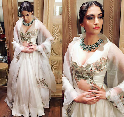 Sonam Kapoor wearing a new dupatta draping style | Sonam in a pretty white and silver lehengas with a sheer white dupatta draped like a cape