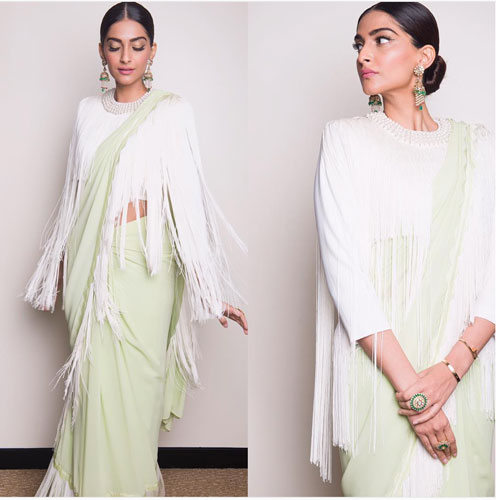Bridesmaid's Dress ideas bollywood flaunted a.k.a Totally trendingWedding Outfit ideas for the Bride's Best friend | Sonam Kapoor in a lime green pastel Abu Sandeep saree with a tassel blouse in white