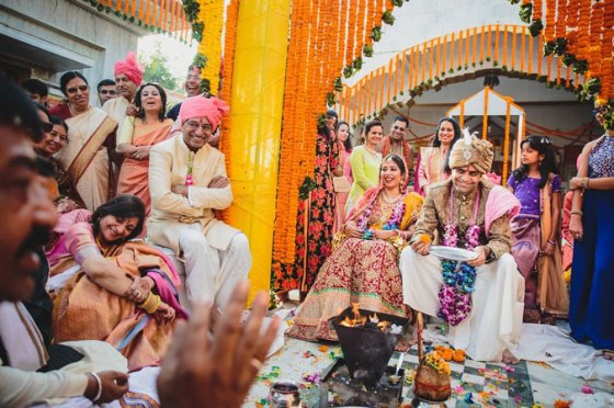 Nimisha and Hemant | Temple wedding in Delhi | The bride and the groom with the family in the wedding at temple.