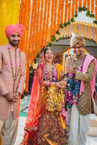Nimisha and Hemant | Temple wedding in Delhi | The bride and groom smiling and laughing during their wedding.