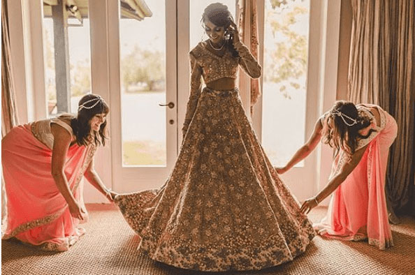 Bridesmaid helping the bride | Bridal lehenga shopping