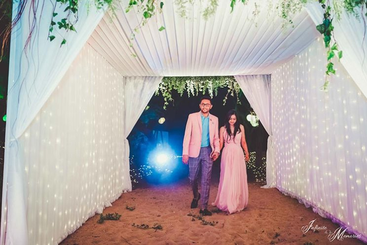 From pretty detailing with flowers and fairy lights to the quirky welcome sign, we must say what a cute night    party on the beach with white canopy and fairy lights