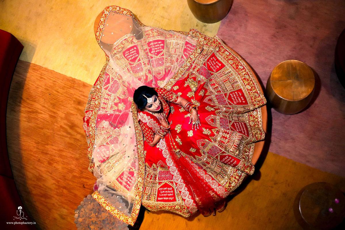 Nindiya Kothari's personalised wedding lehenga | gorgeous red and gold custom lehenga