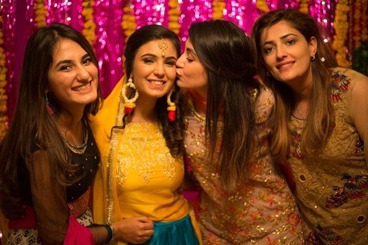 pakistani wedding   blogger bride humna   haldi photos with flower earrings