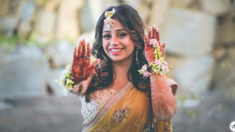aaina and Shagun | hill station wedding in Kasauli with haldi ceremony ideas | pretty bride in a yellow lehengas with floral jewellery and haathphool