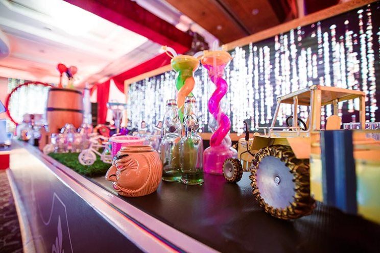 Mihir and Disha - Magical Mumbai wedding | Photo by - the Photo diary | Tiki bar with colourful whimsical Indian bar setup