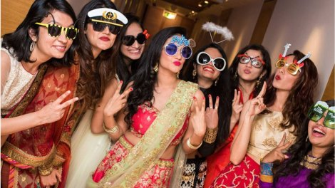 indian bride with her best friends in a fun pose with props | snap soul india