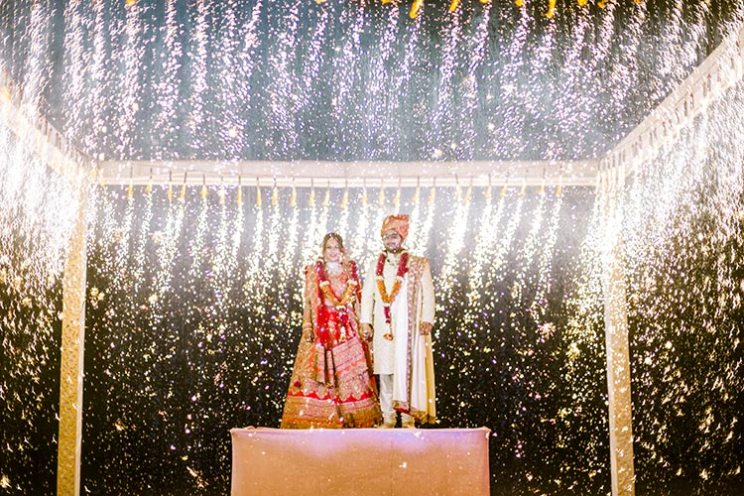 Jaimala with pyro curtain and pyro shower in this Goa wedding by Krayonz entertainment