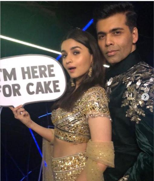 Karan Johar and alia Bhatt pose at teh ambani engagement photo booth