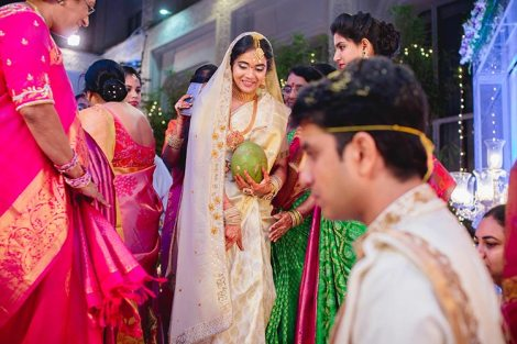 Namrata & Kiran | Personalized wedding in Hyderabad | southindia style wedding ceremony |Bride in a white and gold silk saree | Personalised love story saree border