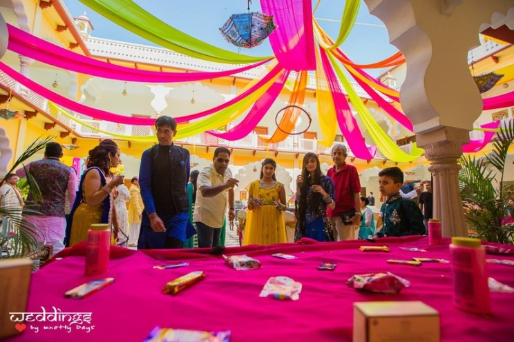 Guests playing games | #JustMaaruThings – Ideas to Celebrate your Teej Function in style