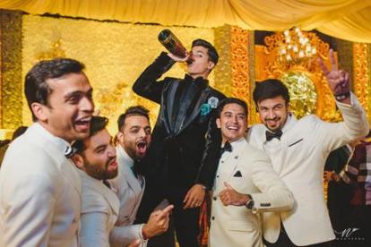Abheshek & Smily - A Chandigarh Wedding full of fun photo | Sabyasachi Sherwani | Groom photo ideas for indian wedings | drinking photos for groom and his buddies | manish malhotra tuxedo for grooms