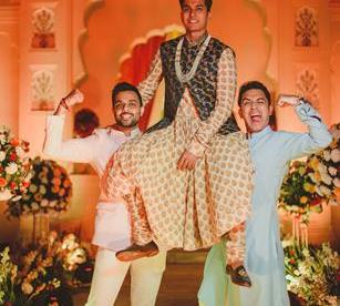 Abheshek & Smily - A Chandigarh Wedding full of fun photo   Sabyasachi Sherwani   Groom photo ideas for indian wedings   Groom on friends shoulders for wedding   printed sabyasachi weddng outfit with waistcoat
