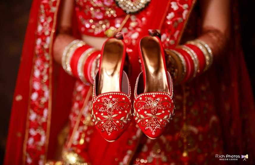 Meghna Sadhwani | Getting ready photo shoot of bride | bridal photo shoot | Bridal Swag | Bridechilla | Swagger Bride | Personalized accessories | Red Lehenga | peresonalised shoes |