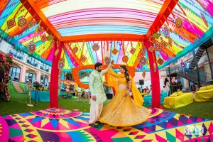 Shrutika & Dirin | Colourful kitsch mehndi in their wedidng in goa | Twirling couple | twirling bride in a yellow lehenga | jasmine mehendi look