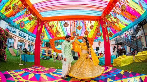 Shrutika & Dirin | Colourful kitsch mehndi in their wedidng in goa | Twirling couple | twirling bride in a yellow lehenga | jasmine mehendi look