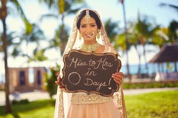 cute indian wedding signs | bride holding signs