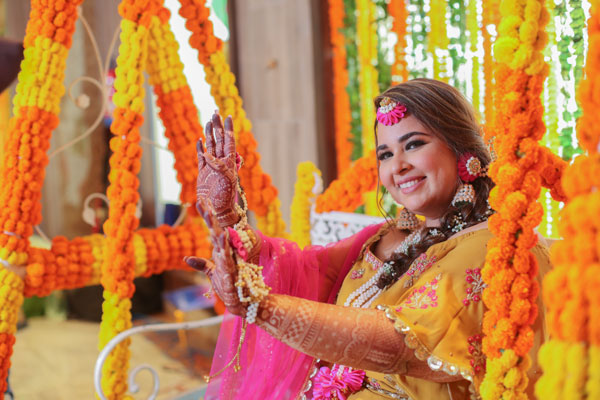 Bride-to-be | Getting married | Mehndi decor | Flowers |