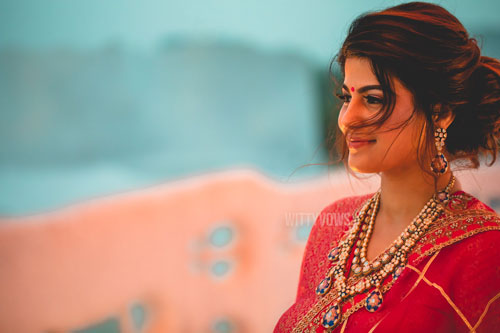 bride in a red traditional blouse