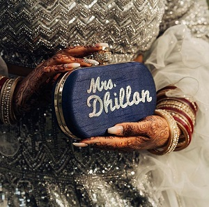 Personalised clutch | Wedding trends | Mrs. | New ideas | Inspiration | #indianwedding #indianbride2020 #customisedclucth #indianbridaltrend2020 #wittyvows #latestweddingtrends #bigfatindianwedding