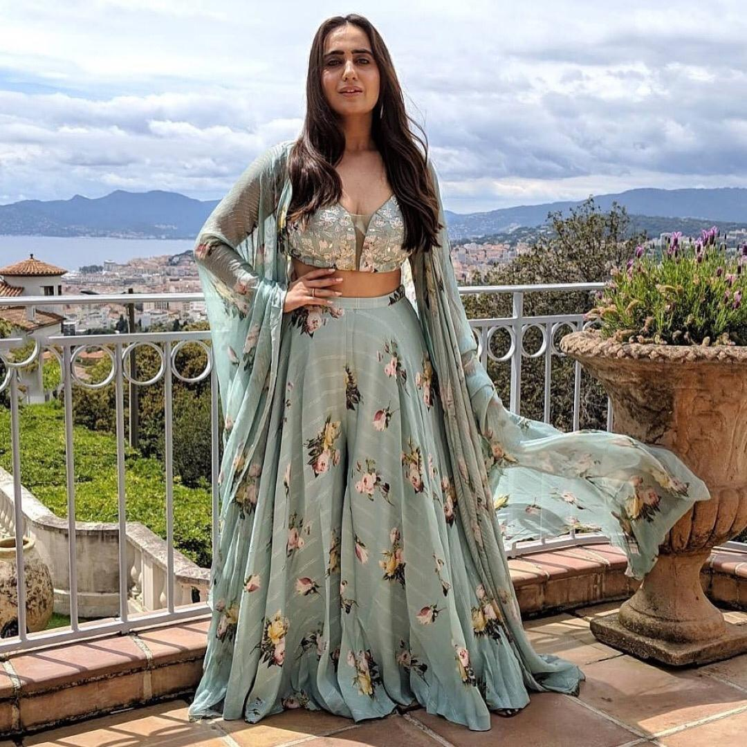 pastel blue crop top skirt and cape | floral print outfit | indian bridesmaids outfit | flower print | kusha kapila | indian lehenga | designer outfit for bridesmaids | caoe and skirt | printed lehenga and crop top and cape