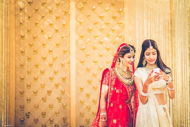 Bride and her sister | Sister of the bride | Planning a wedding on Internet |
