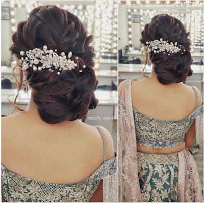curled side bun with a pearl studded accessory