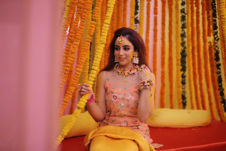 bride to be posing for pictures on her wedding day  |Karishma & Pratham - a love story of two advocates