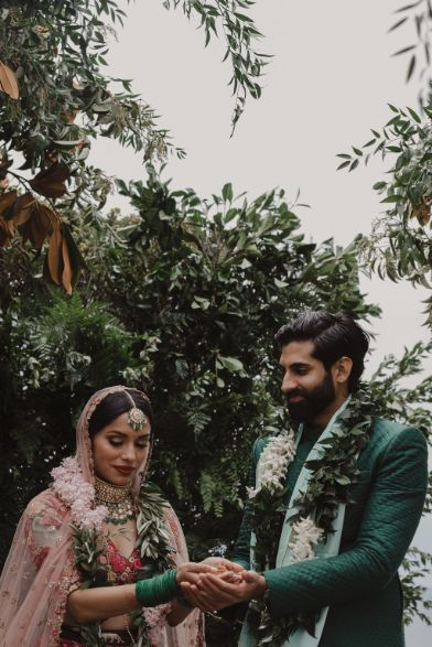 bridea and groom captured having some moments between their marriage ceremony | a stunning wedding in California