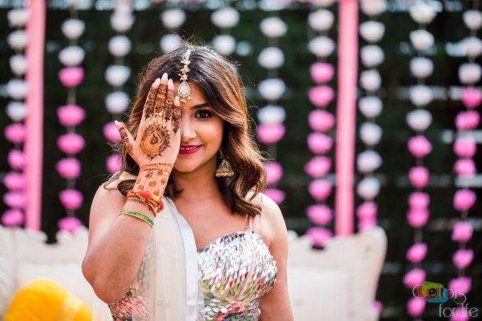 indian bridal mehendi poses | Bridal Lehenga Designed by the Bride