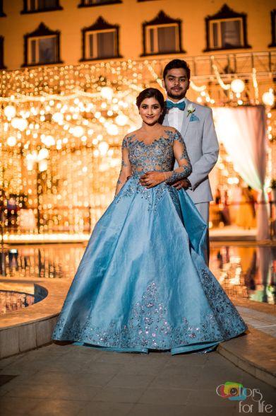 Stunning couple portrait pose | Bridal Lehenga Designed by the Bride