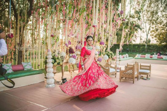 twirling bride | Sabyasachi Lehenga for Mehendi