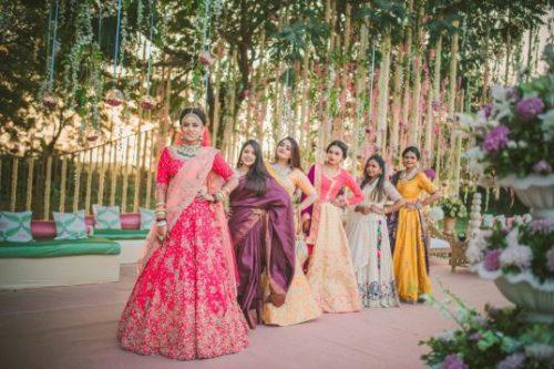 bridesmaids at photoshoot | stunning Indian bride in bridal lehenga