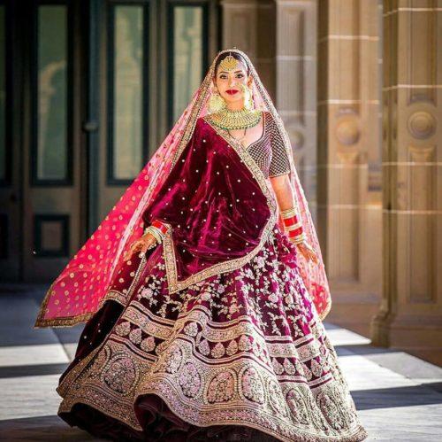 twirling shot | twirling bride | twirling lehenga bride | maroon lehenga | red bridal lehnga | latest red bridal lehenga | velvet lehenga | Lehenga Colour trends | orange bridal lehenga | wittyvows | 2020 lehenga trends for indian brides | chooda designs | #wittyvoes #lehenga #2020bridallehenga #bridallehengacolours #lehengacolours #redlehengha #maroonlehenga #bridesofwittyvows