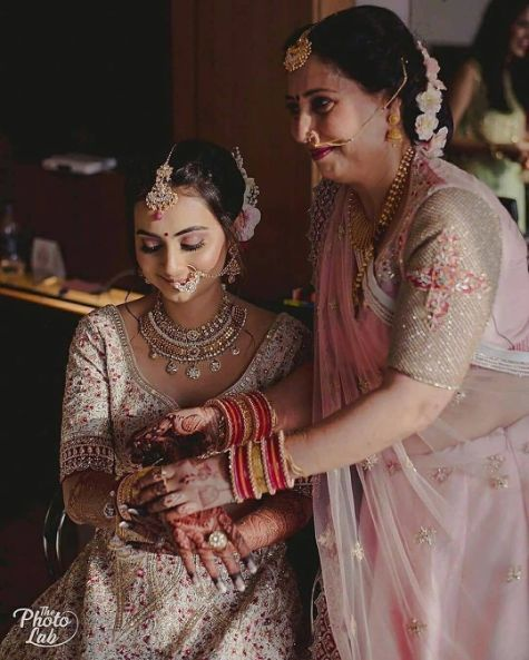 | brid and groom | mumbai bride | floral hair style | mothers l;ove for a bride