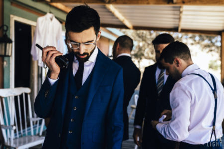 walky talky   indian groomsem at wedding   boys at duty