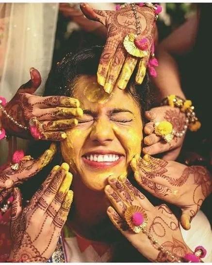 haldi application on the bride | Wedding Trends for Haldi Ceremony