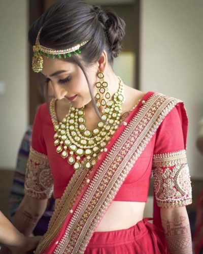 red lehenga outfit for 2020 brides | polki necklace trends to wear for 2020 wedding | latest diamond necklaces bridal necklace desings for 2020 brides | polki jewellery necklace ideas to wear at your indian wedding | choker polki necklaces for indian brides #wittyvows #polkijewllery #indianbride #2020weddings #diamondnecklaces #polkinecklaces #trendingjewllery #bridaljewllery #bridallehnga | indian wedding polki jellwery designs , bridal becklaces for indian brides