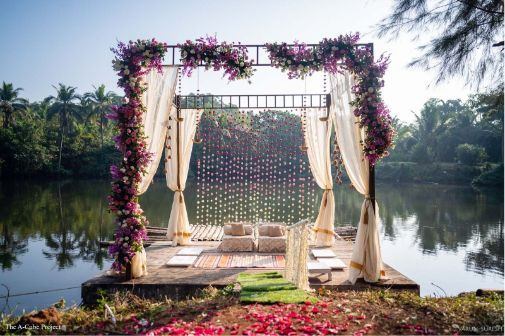 stunning mandap decor | white drapes and floral decor | wedding in Kerala